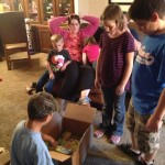 Kiddos opening the Party Pack from House Party!