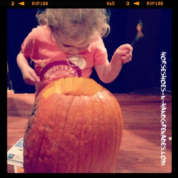 My Bella checking out the Guts of her pumpkin.