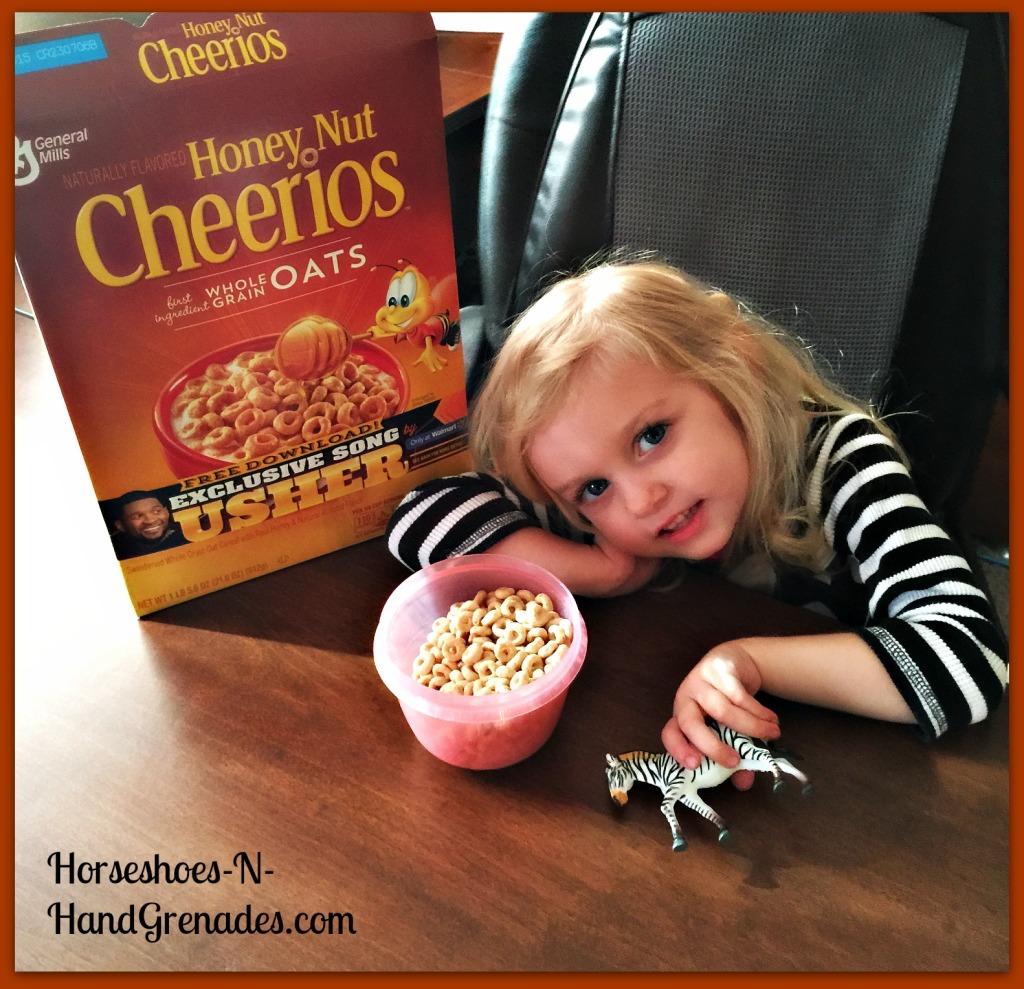 Bug having her morning bowl of Honey Nut Cheerios and listening to Usher. Even Zebra loves them!