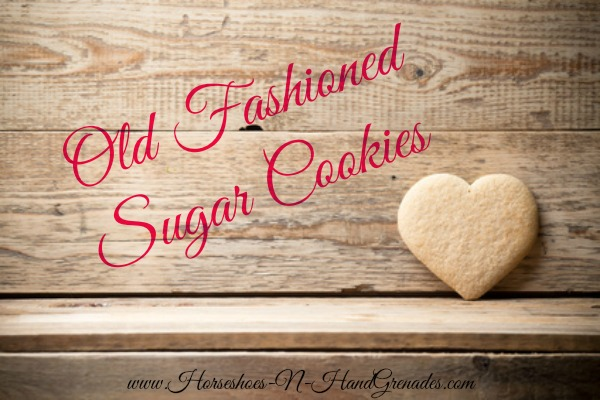 Heart-shaped biscuit on wooden background.
