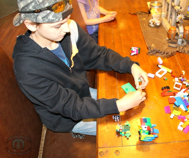 My son creating - he's always so serious!