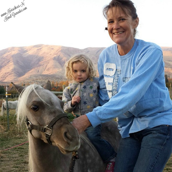 My daughter Bella with Grandma Syndi and her first pony ride.